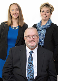 Courtney Zechman, and Amy Dellinger (Back) with Wes Dellinger (Front) of the Dellinger Real Estate Group of Brownstone Real Estate