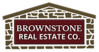 The logo for Brownstone Real Estate Company