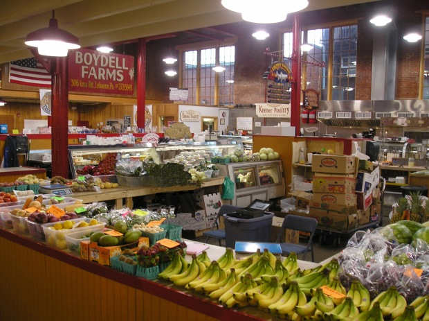 Interior of farmers market in Lebanon, PA showing stands with fresh produce
