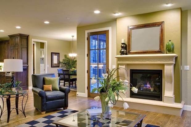 Great room with view of patio door, breakfast nook, and edge of kitchen.
